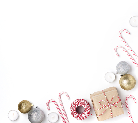 Frame from golden and silver balls, gift, candles, lollipops, Top view White Background Christmas New Year Standard-Bild