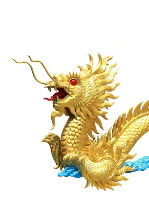 dragon vertical: vertical golden dragon statue with isolated background Stock Photo