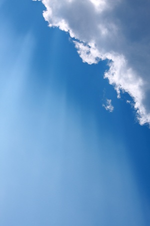 Sunbeam  through the haze on blue sky: can be used as background and dramatic look Stock Photo