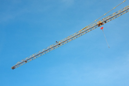 crane building construction with blue sky background photo