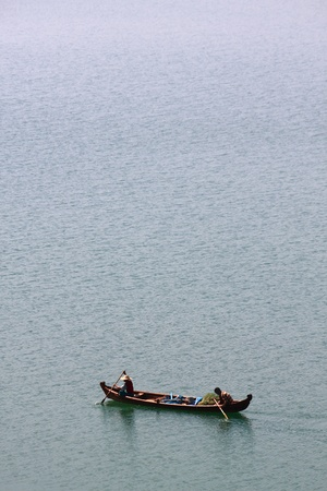 non urban scene: People rowing wherry in lake, non Urban scene