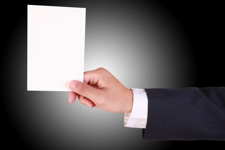 business man hold blank paper isolated on white background photo