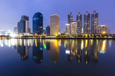 night time of Bangkok with water reflection Stock Photo