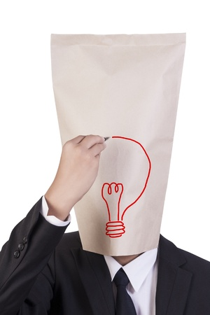 Businessman cover head drawing his face about idea photo