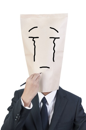 Businessman cover head drawing his face about his emotion