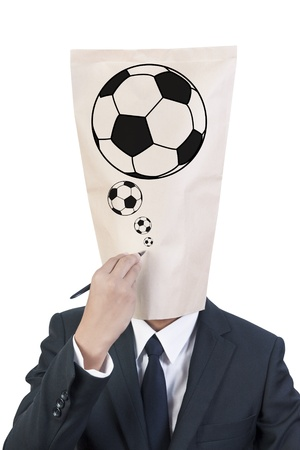 Businessman cover head write football sign on his face  photo