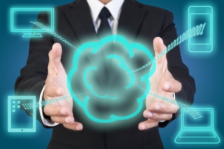 Businessman holding graphic of cloud computing Stock Photo - 14092894