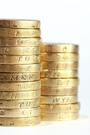 one pound coin stack close up shot