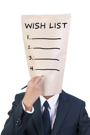 wish list: businessman cover head writing wish list Stock Photo