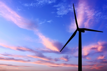 wind turbine generator with twilight sky on background photo