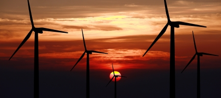 wind turbine generator with sunset on background photo
