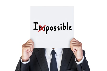 able: Businessman holding paper that say I possible