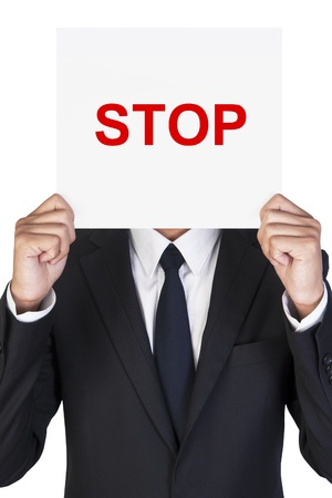 Businessman holding paper that say STOP
