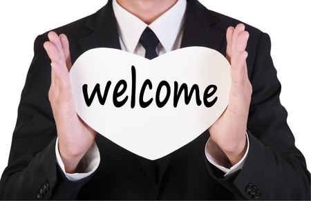 Businessman holding paper written welcome photo