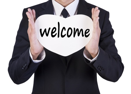 Businessman holding paper written welcome Stock Photo - 14660529
