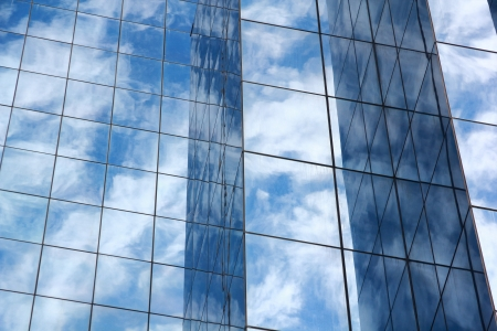 blue mirror glass building with cloud, blue sky and sunlight : exterior building  photo