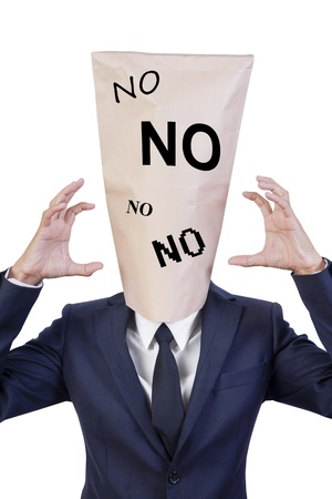 businessman cover head with bag that show NO NO NO photo