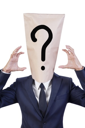 businessman cover head with bag that show question mark photo