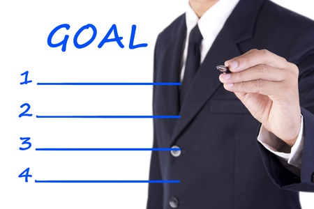 intention: businessman writing goal list for planning
