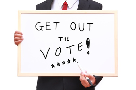 businessman invite people for voting on white board photo