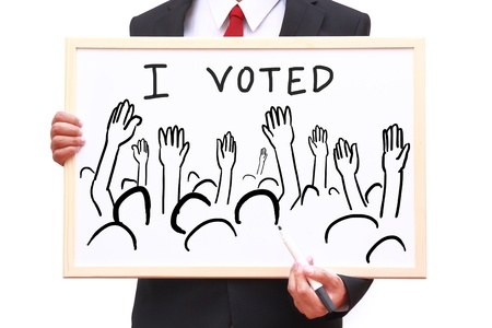 i voted: businessman show people group with i voted on white board