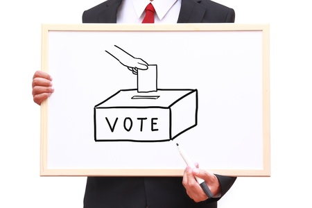 businessman invite people for voting on white board Stock Photo - 16840612