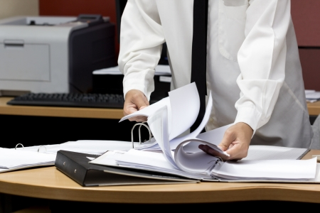 businessman search paper from file Stock Photo - 19158100