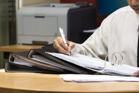 Businessman writing paper in file , hard work to do Stock Photo - 19158101