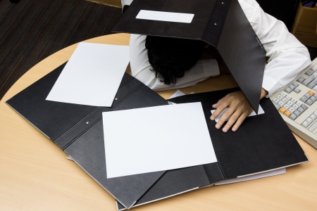 Businessman sleep during working Stock Photo - 19158104