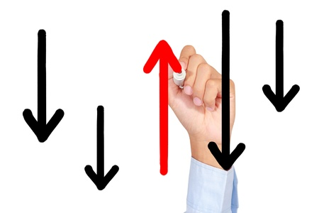 against the flow: A man is drawing red arrow line against the flow