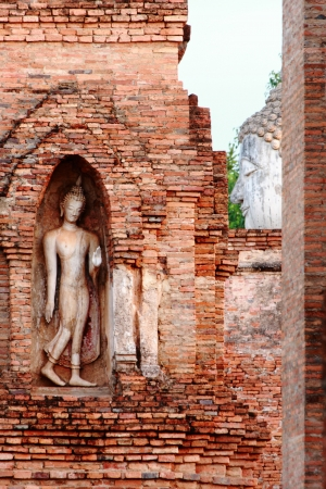 Bas relief buddha image at Mahathat temple, Sukhothai Historical Park, Sukhothai, Thailand photo