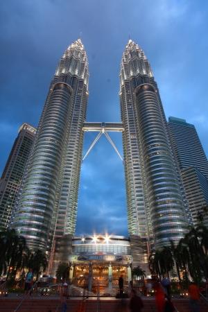 KUALA LUMPUR - FEBRUARY 12: The Petronas Twin Towers are the  worlds tallest twin towers. The skyscraper height is 451.9m. February 12,  2012, in Kuala Lumpur, Malaysia