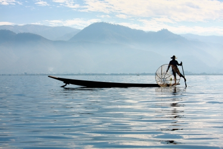 Intha people possess the leg-rowing style and the unique coop-like fishing equipment