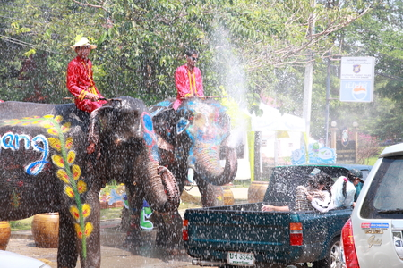 13 15 years: AYUTTAYA, THAILAND - APRIL 14: Songkran Festival is celebrated in a  traditional New Years Day from April 13 to 15, with the splashing water with  elephants on April 14, 2012 in Ayuttaya, Thailand. Editorial