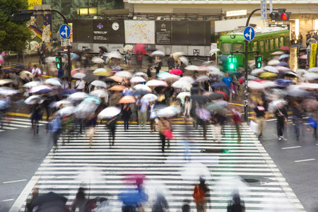 TOKYO, JAPAN - OCTOBER 25: Pedestrians cross at Shibuya Crossing on Oct 25, 2013. The intersection is known as the busiest in the world. Editorial