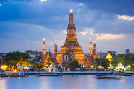 Wat Arun temple gold lighting after sunset with blue sky