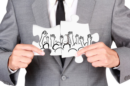 uphold: Concept teamwork concept Businessman showing jigsaw connect create people connection teamwork concept isolated on  white