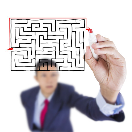 Concept business draw shortcut exit from maze problem above whiteboard white background Standard-Bild