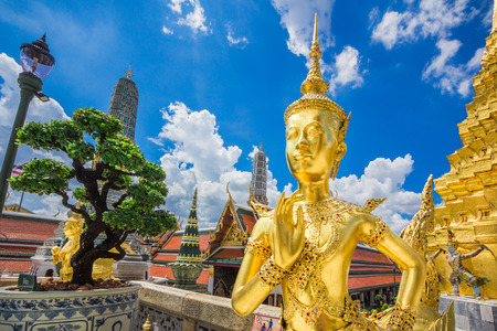 Temple or wat in Bangkok Thailand. Kinnaree sculpture is mythological creature, half of bird and girl at Wat Phra Kaew also called Grand Palace. photo