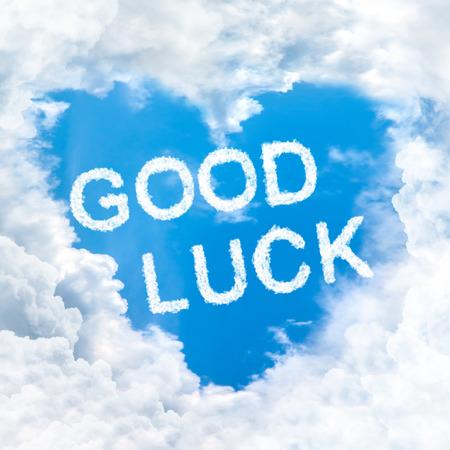 good luck word on blue sky inside heart cloud form photo