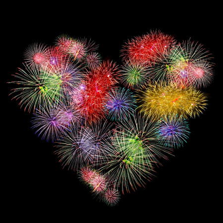 fireworks colorful heart shape on black background