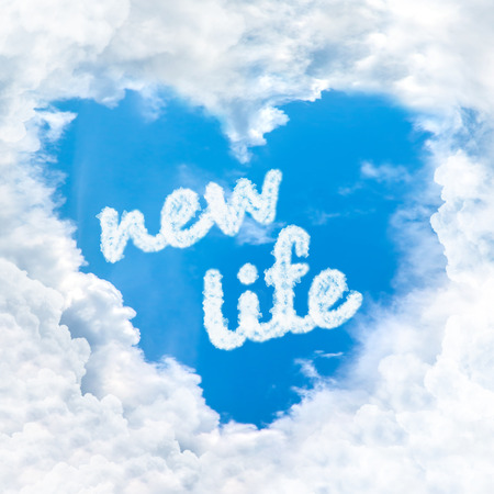 new life word inside love cloud heart shape blue sky background only photo