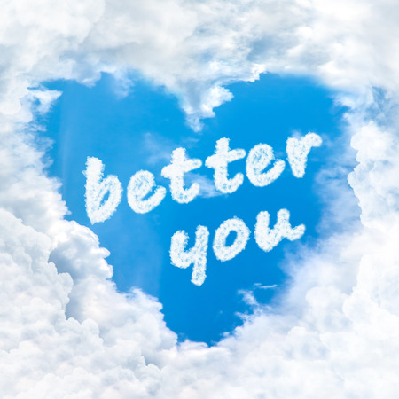 better you word inside love cloud heart shape blue sky background only Stock Photo