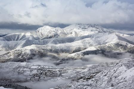 neighbourhood: layer mountain ridge snow landscape neighbourhood of huanglong china Stock Photo