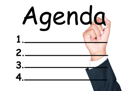 meeting agenda: Agenda list write by businessman on white background Stock Photo