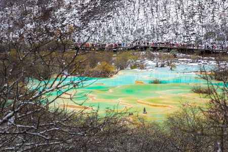 huang: Huanglong Area with green pond in winter snow season, Sichuan, China