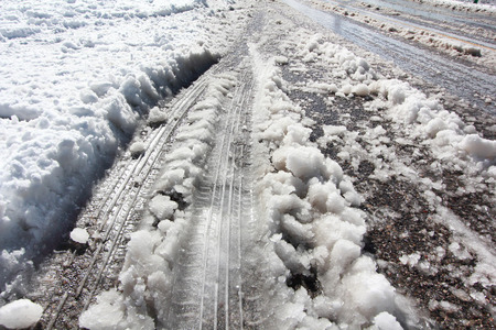 tire marks: tire track marks on snow cover road in winter