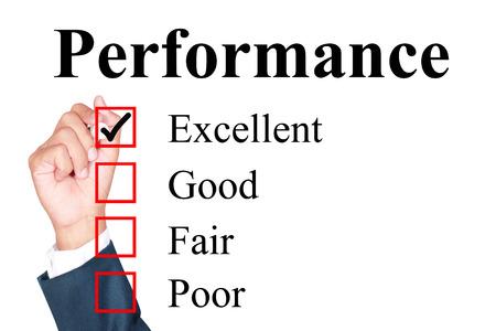 uitstekend: Performance evaluation form tick excellent by businessman