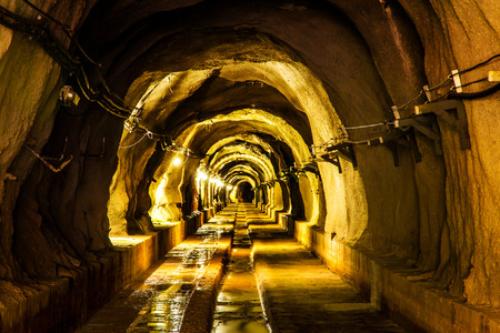 mining gold: cave tunnel mine long walk way with light