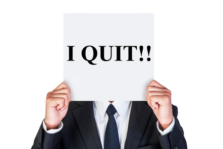 say: Say i quit word on paper shown by business man isolated on white background